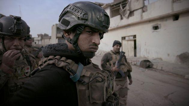 Sergeant Amjad Al-Rakabi on patrol in West