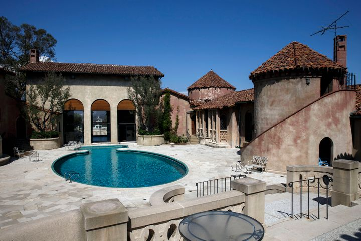 The 8-acre property features panoramic views and Roman villa-style buildings.
