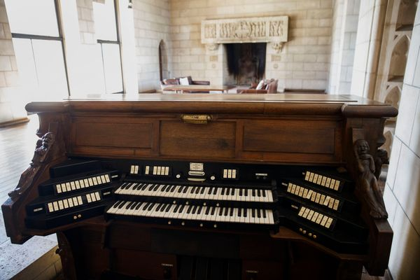 A pipe organ keyboard stands ina room that once housed a chapel.