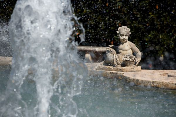 A sculpture gazes at a fountain in front of the sisters' former home.