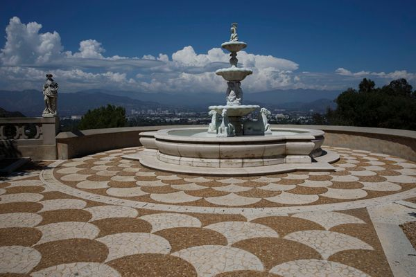 A fountain overlooks the valley and the city of Los Angeles.