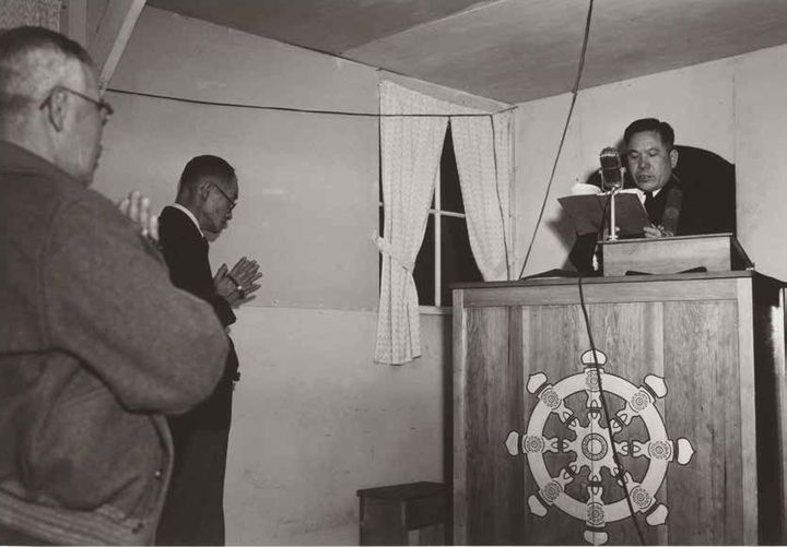 Buddhist service at Manzanar Relocation Center in California where many Japanese Americans were incarcerated during the Secon