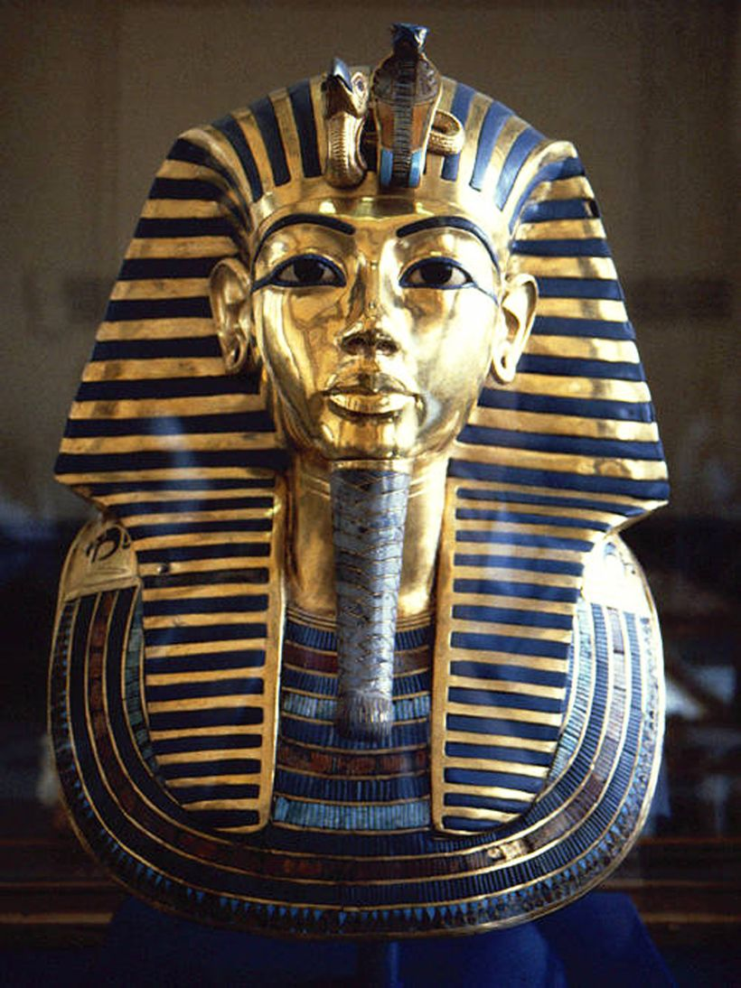 """The eyebrows and """"eyeliner"""" on King Tut's golden funeral mask were made of lapis. Other blues on it were said to have been ma"""
