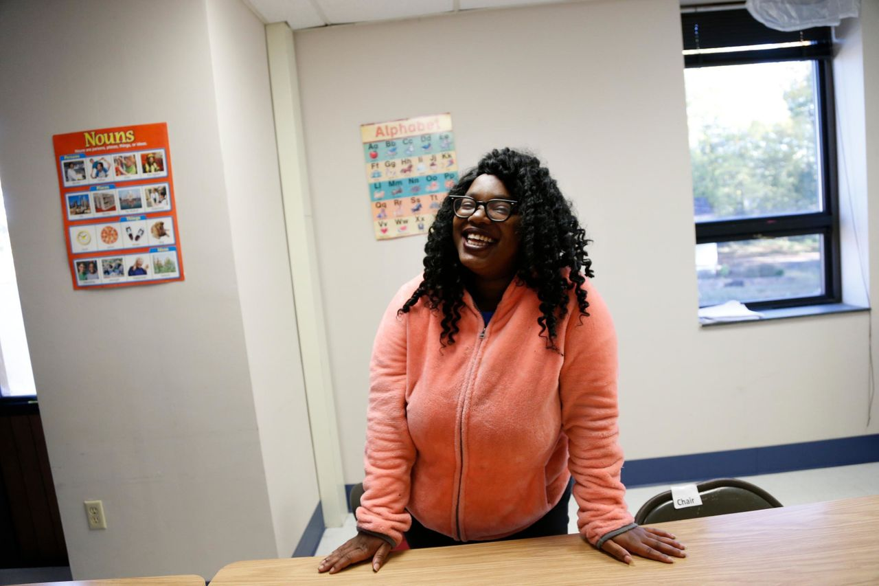 Kenyatta Burns poses for a portrait before working with her tutor at the Durham Literacy Center on Thursday, Nov. 20, 2017, in Durham, N.C.