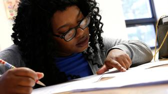 Kenyatta Burn works with her tutor at the Durham Literacy Center on Thursday, Nov. 20, 2017, in Durham, N.C.(AP Photo/Brian Blanco)