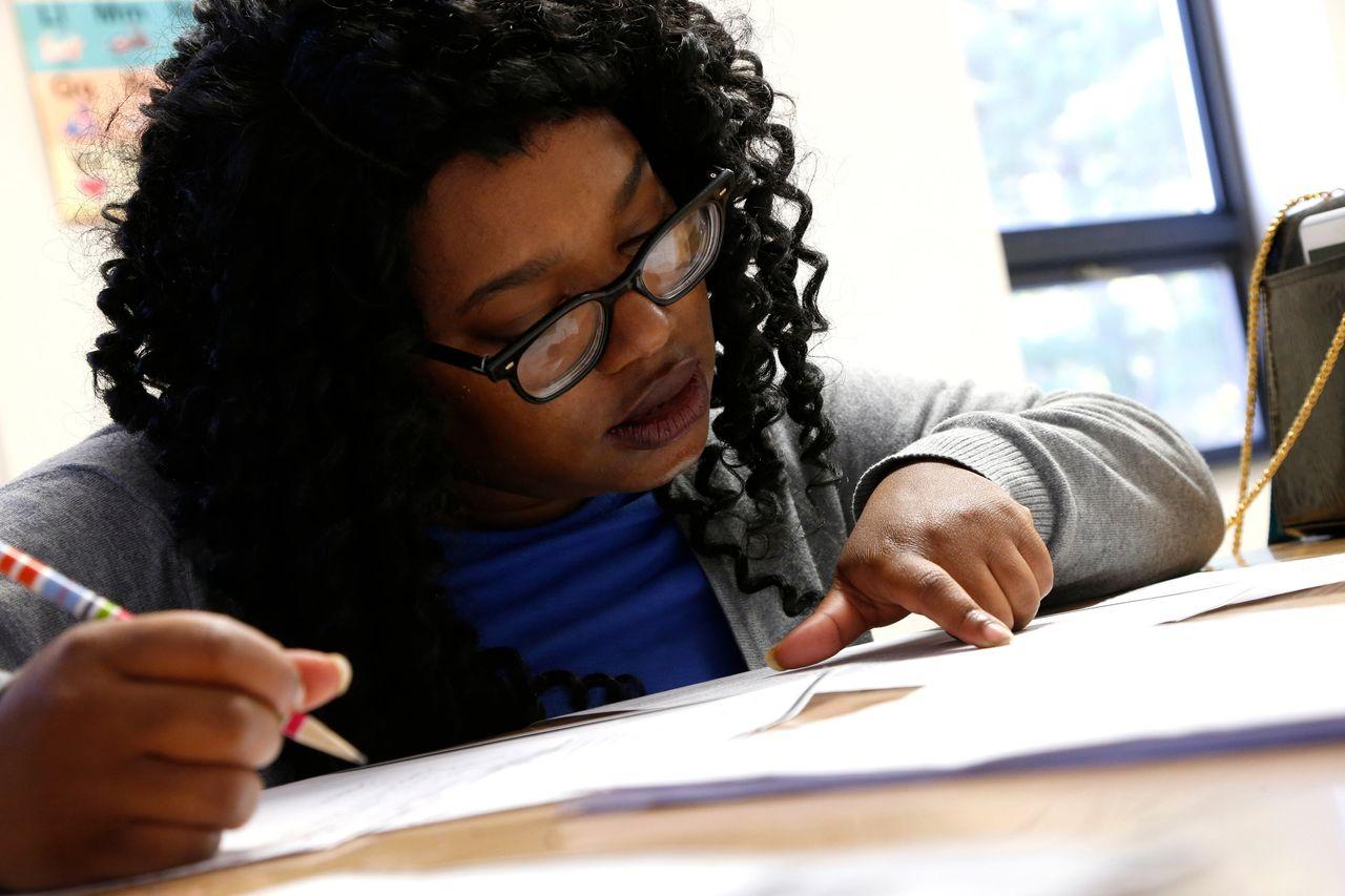 Kenyatta Burns works with her tutor at the Durham Literacy Center on Thursday, Nov. 20, 2017, in Durham, N.C.