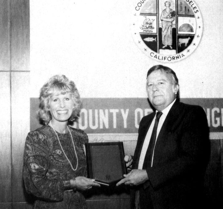 Christina receiving an award for three years of service as Los Angeles County Commissioner for Children's Services