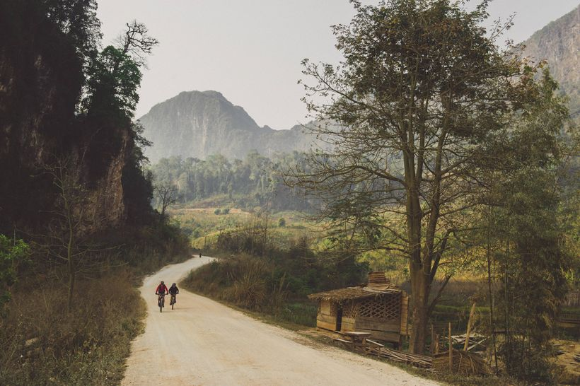 Rebecca Rusch and her riding partner, Huyen Nguyen, pedal the Ho Chi Minh trail in Laos on February 26, 2015