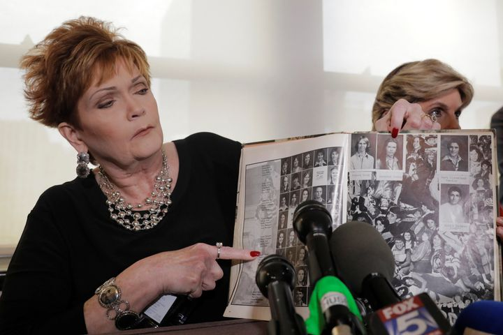 Beverly Young Nelson points to a photograph of herself in her high school yearbook after claiming that Moore sexually harasse