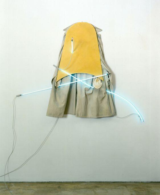 Mario Merz,  <em>Impermeabile (Raincoat), </em>Raincoat, 1966, wood, wax, neon Overall: 126 x 170 x 40 cm / 49 5/8