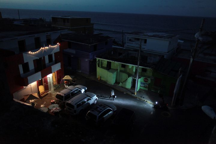 In San Juan, a generator lights up a house on an otherwise dark block on Oct. 26, 2017.