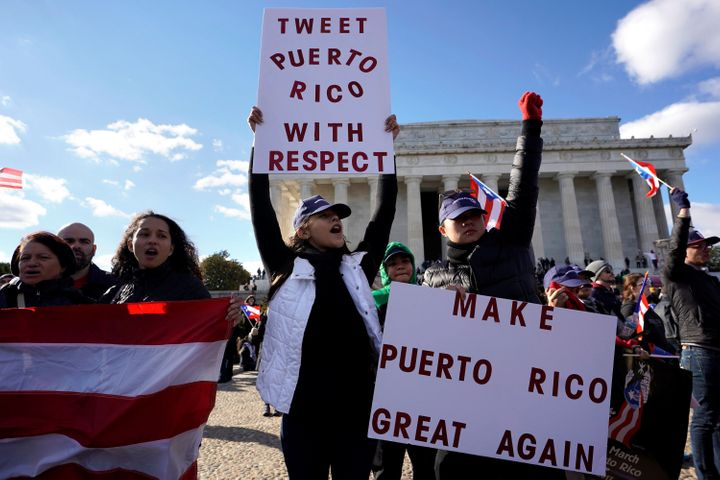 Protesters in front of the Lincoln Memorial on Sunday call on Congress to send more aid to Puerto Rico.