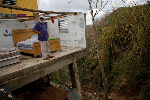 On Oct. 11, 2017, Roberto Morales Santos, 70, looks out from his damaged San Juan