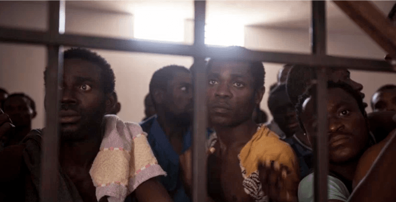 <em>Young Africans being held to be sold as slaves in Libya. </em>