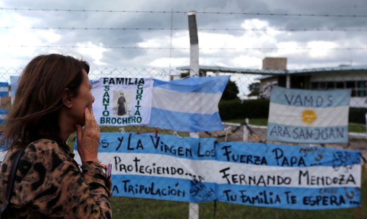 Signs in support of the 44 crew members of the missing submarine at the Argentine Naval Base where the craft sailed from, five days ago