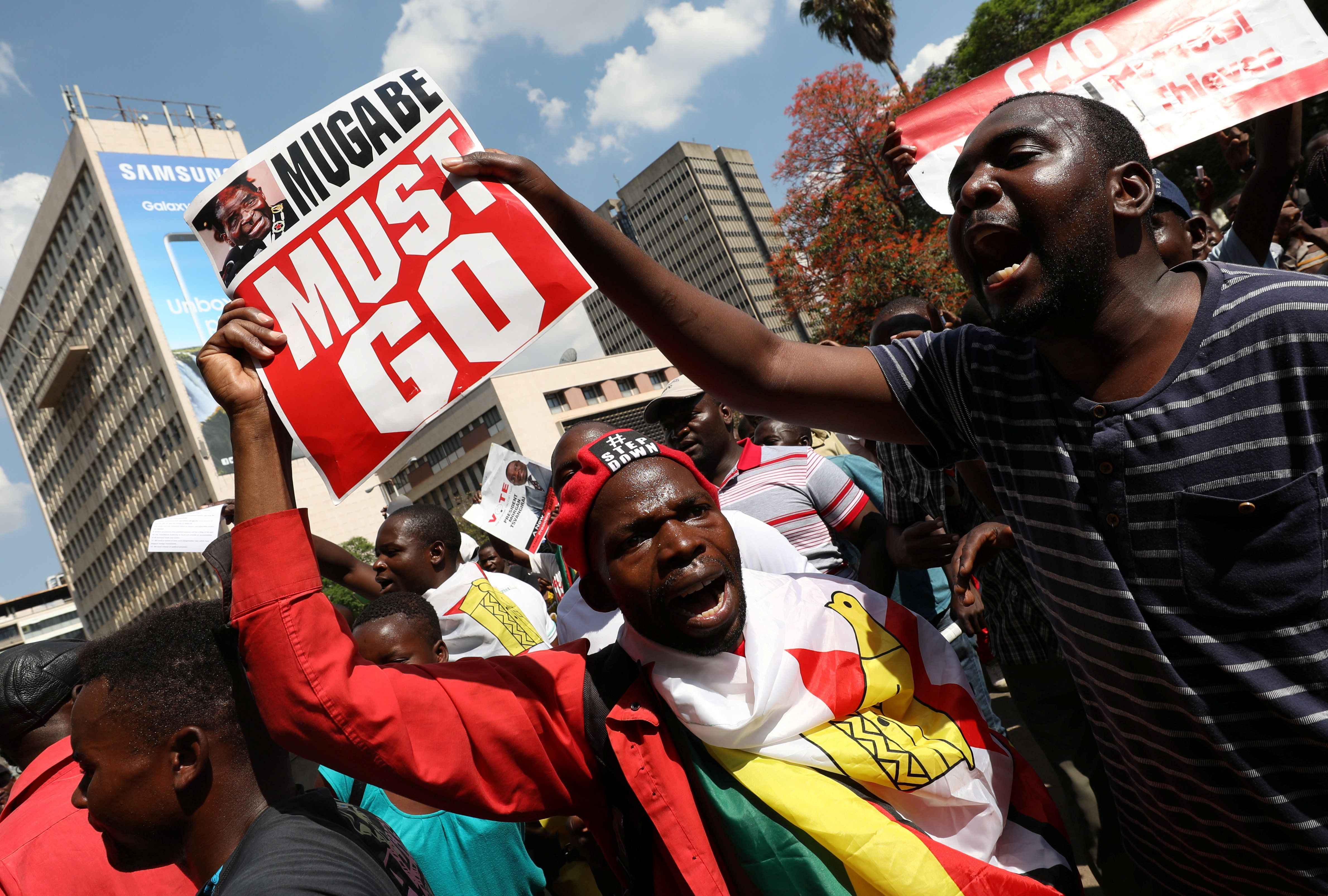 Protesters calling for Zimbabwean President Robert Mugabe to resign demonstrate outside parliament in Harare, Zimbabwe, November 21, 2017. REUTERS/Mike Hutchings