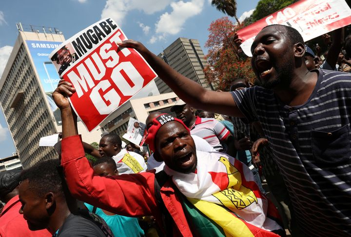 Protesters calling for Zimbabwean President Robert Mugabe to resign demonstrate outside parliament in Harare, Zimbabwe, Novem