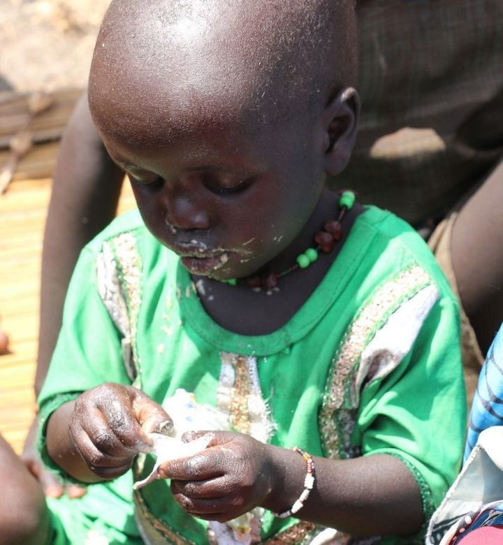 Two-year old Nyantaba Gakier eats nutritious food provided by humanitarian partners in Thonyor.  Small children in South Suda
