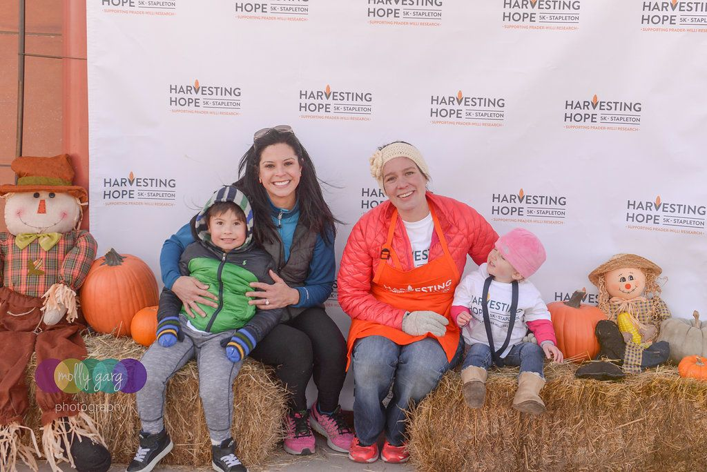 Rachael Fischer (left, with her son Jude) and Julie Hoge (right, with her daughter Eliza) teamed up to hold a 5K run and