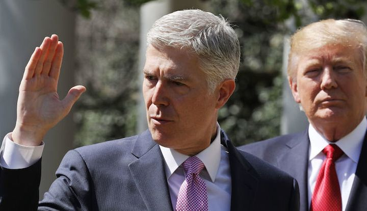 <p>U.S. Supreme Court Justice Neil Gorsuch takes the judicial oath in April 2017.</p>