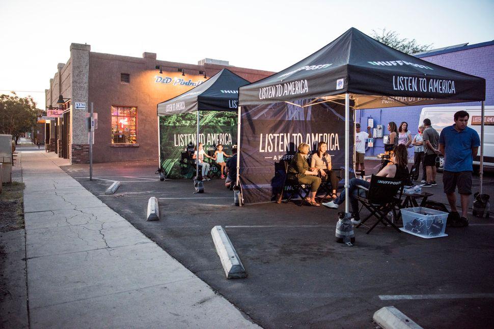 People are interviewedin tents in Tucson, Arizona.