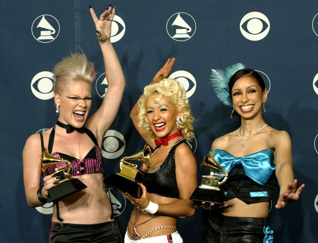 Pink, Christina Aguilera and Mya pose with the Grammy Award they won for