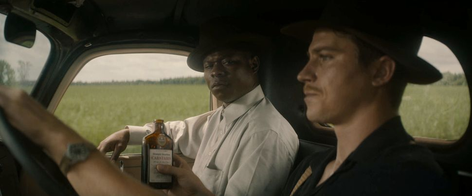 "Jason Mitchell and Garrett Hedlund star in ""Mudbound."""