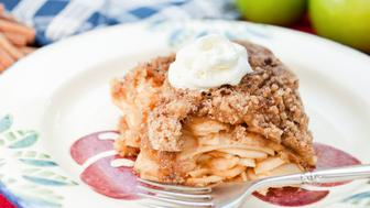 """Apple Crumble also known as Apple Crisp, with cream on topMore like this"""