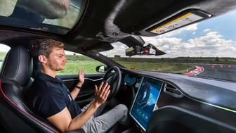 A test driver removes his hands from the steering wheel of a Tesla Motors Inc. Model S electric automobile fitted with self driving technology, developed by Robert Bosch GmbH, during the Bosch mobility experience in Boxberg, Germany, on Tuesday, July 4, 2017. Auto supplier Bosch will build a 1 billion-euro ($1.1 billion) semiconductor plant, the biggest single investment in its history, as the maker of brakes and engines prepares for a surge in demand for components used in self-driving vehicles. Photographer: Andreas Arnold/Bloomberg via Getty Images