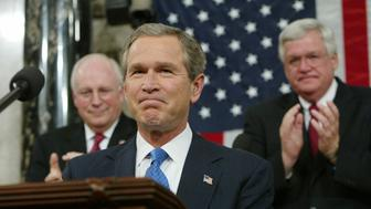 """U.S. President George W. Bush acknowledges applause as he arrives to address a Joint Session of Congress at the Capitol Building in Washington January 28, 2003. Bush braced wary Americans for a possible war with Iraq on Tuesday night by saying in his State of the Union speech that Baghdad has shown contempt for U.N. disarmament demands and that """"some crucial hours may lie ahead"""" for U.S. troops. REUTERS/POOL/Pablo Martinez Monsivais  HK/ME"""