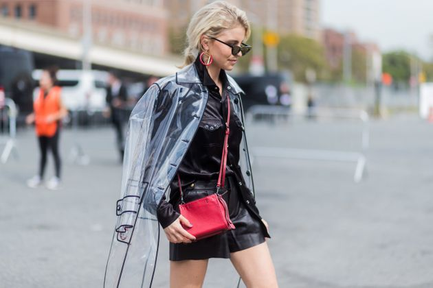 Blogger Caroline Daur wearing a clear PVC raincoat by Miu