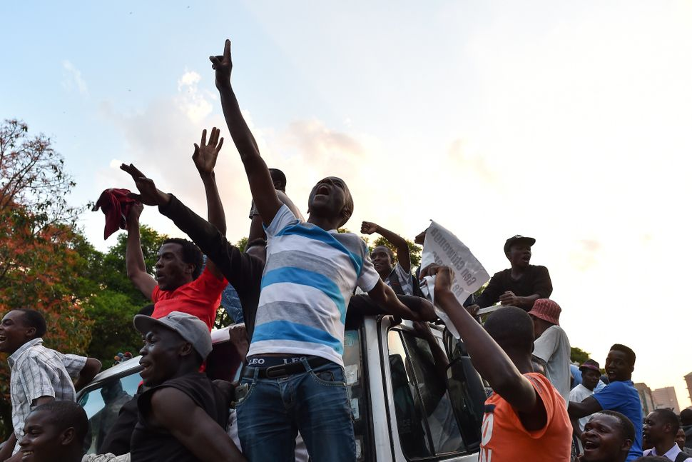 People celebrate in the streets of Harare.