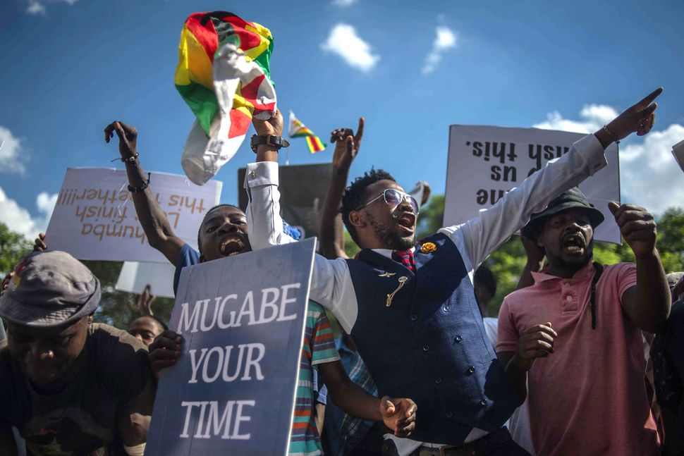 Zimbabweans shouts as they gather at Unity square opposite to the parliament.