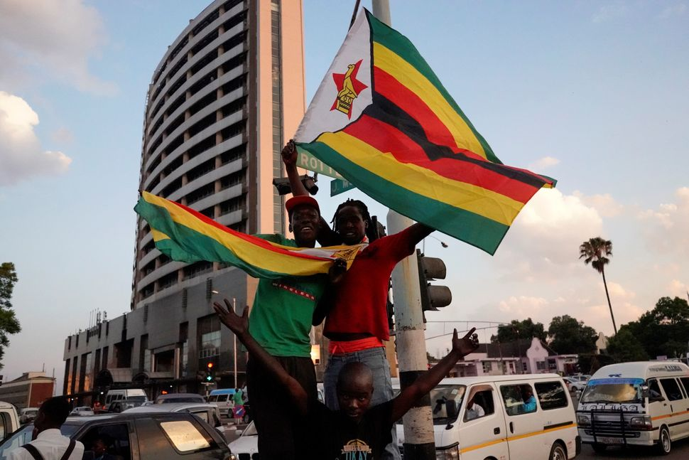 Car horns blared and cheering crowds raced through the streets Harare as news spread that Mugabe had resigned after 37 years
