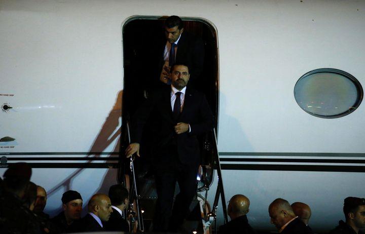 Hariri walks down the steps at Beirut's international airport.