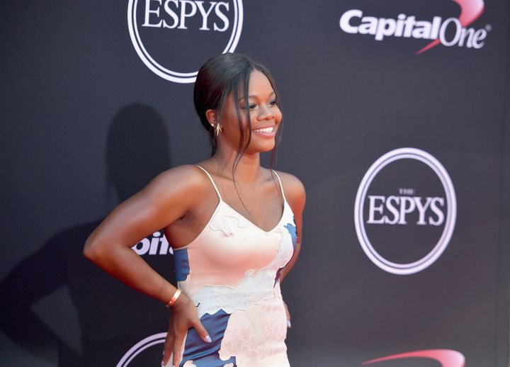 Gabby Douglas also apologized for a tweet she wrote last week that criticized women who dress provocatively after fellow Olym