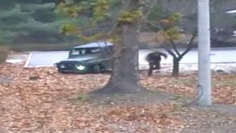 A North Korea soldier is shown defecting into South Korea in these still images taken from a video released by the United Nations Command (UNC) on November 22, 2017. (Top) A North Korean soldier drives a military vehicle towards the border, passing checkpoints manned by North Korean guards before appearing to get stuck in a ditch (centre), where he gets out and dashes into South Korea as North Korean border guards (not pictured) open fire. (Bottom) The wounded defector lies on the ground before South Korean soldiers (not pictured) crawl through undergrowth to drag him to safety.  United Nations Command/Handout via REUTERS ATTENTION EDITORS - THIS IMAGE HAS BEEN SUPPLIED BY A THIRD PARTY. IT IS DISTRIBUTED, EXACTLY AS RECEIVED BY REUTERS, AS A SERVICE TO CLIENTS.