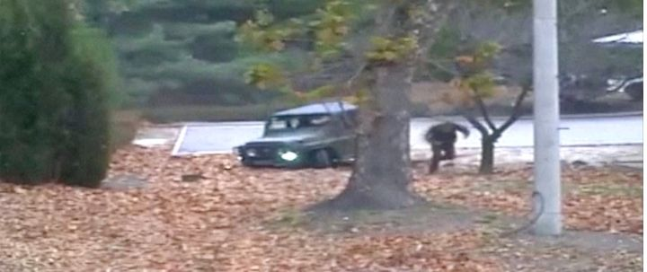 A North Korean soldier can be seen defecting into South Korea in this image taken from a video released by U.N. Command this