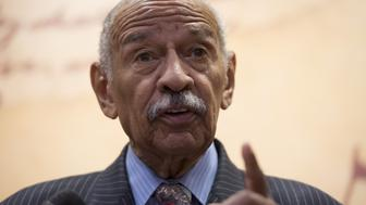 US Representative John Conyers, Democrat of Michigan, speaks regarding a lawsuit members of Congress have filed against US President Donald Trump for violating the emoluments clause of the US Constitution which bans Presidents from accepting payments, benefits or gifts from foreign states without the consent of Congress, during a press conference on Capitol Hill in Washington, DC, June 20, 2017. / AFP PHOTO / SAUL LOEB        (Photo credit should read SAUL LOEB/AFP/Getty Images)