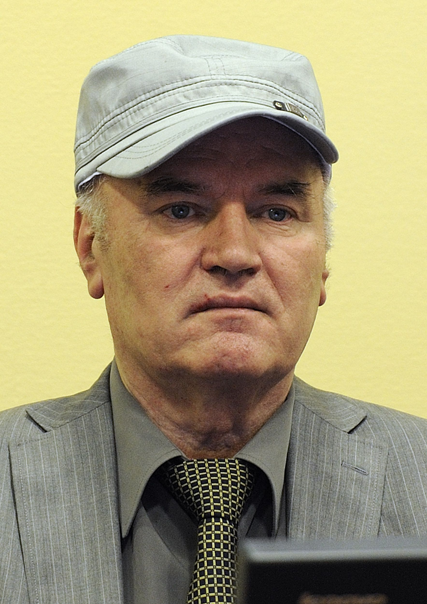 (FILES) Wartime Bosnian Serb General Ratko Mladic sits in the court room during his initial appearance at the UN Yugoslav war crimes tribunal in The Hague on June 3, 2011. Bosnian Serb ex-army chief Ratko Mladic, who faces charges of genocide, crimes against humanity and war crimes, will go on trial on May 14, the Yugoslav war crimes tribunal said on February 15, 2012.  AFP PHOTO / Martin Meissner (Photo credit should read MARTIN MEISSNER/AFP/Getty Images)