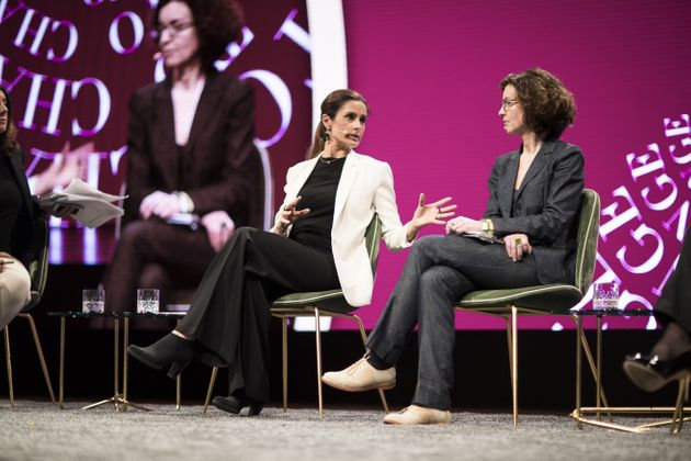 Livia Firth (left) and Jessica Simor QC (right) speaking on a panel chaired by Lucy Siegle at Copenhagen...