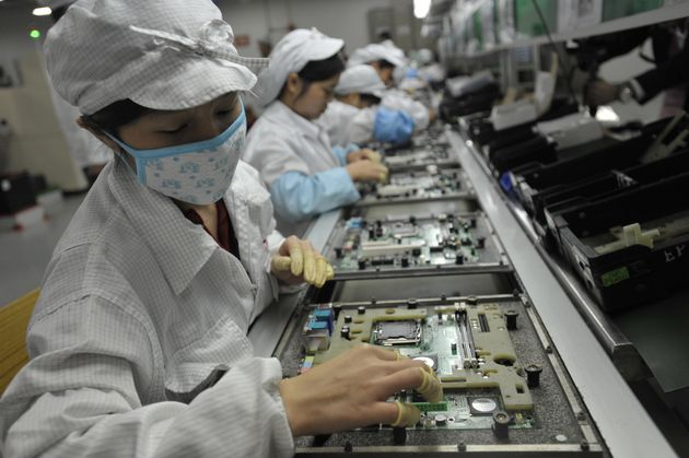 Chinese workers are seen at a Foxconn factory in Shenzhen in 2010. The contractor for Apple products...