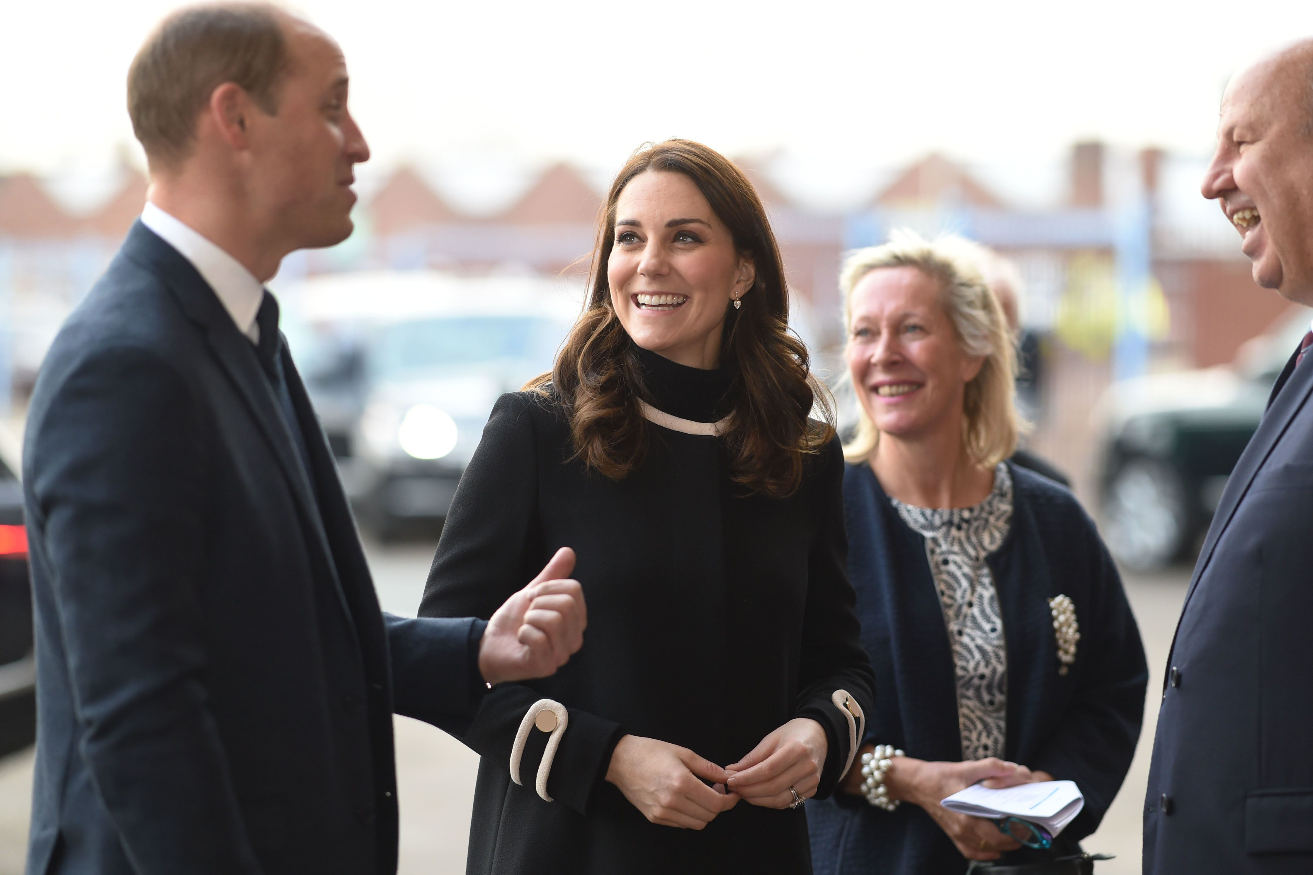 Britain's Prince William, Duke of Cambridge and Britain's Catherine, Duchess of Cambridge gesture on their arrival at Aston Villa Football Club to see the work of the Coach Core programme, in Birmingham on November 22, 2017.  / AFP PHOTO / POOL / Geoff PUGH        (Photo credit should read GEOFF PUGH/AFP/Getty Images)