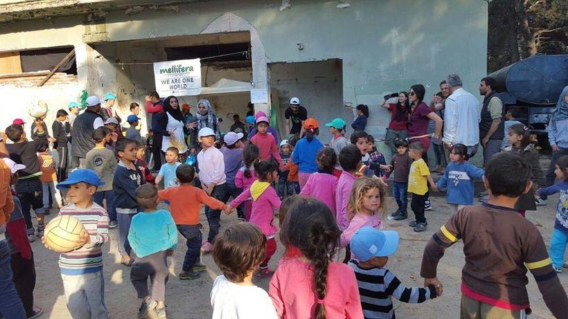 <em>Children of the Ritsona Refugee Camp dance and play </em>