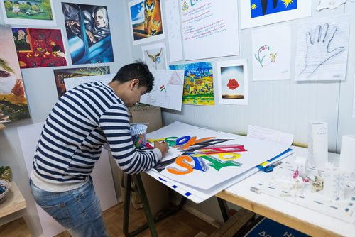 <em>A member of the Youth Empowerment Space community creates art for the Ritsona Kingdom Journal </em>