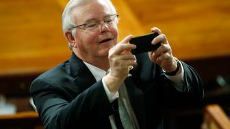 U.S. Rep Joe Barton (R-TX) takes a picture in the House chamber prior to Israeli Prime Minister Benjamin Netanyahu's address to a joint meeting of Congress on Capitol Hill in Washington, March 3, 2015. REUTERS/Jonathan Ernst (UNITED STATES  - Tags: POLITICS)