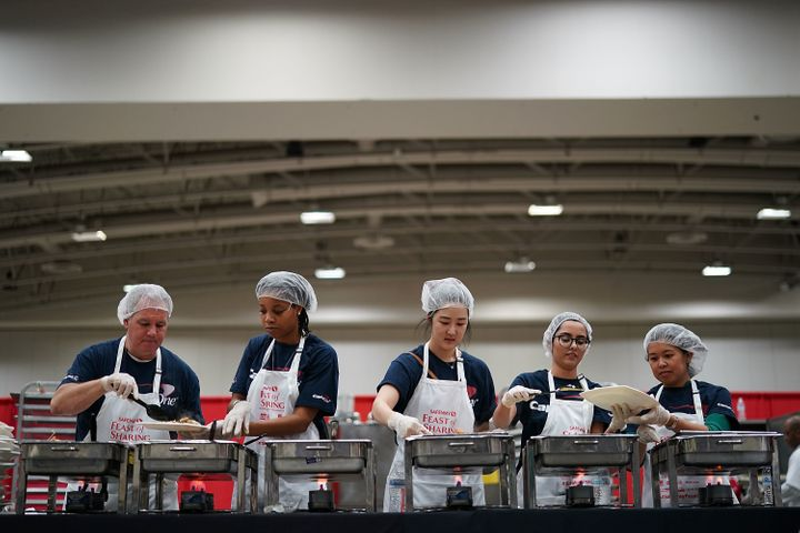 Volunteers with Capital One help plate Thanksgiving dinner for more than 5,000 District of Columbia residents during Salvatio