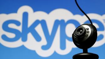 FILE PHOTO: A web camera is seen in front of a Skype logo in this photo illustration May 26, 2015. REUTERS/Dado Ruvic/File Photo