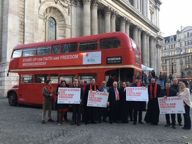 Participants attend a #RedWednesday event in central London.