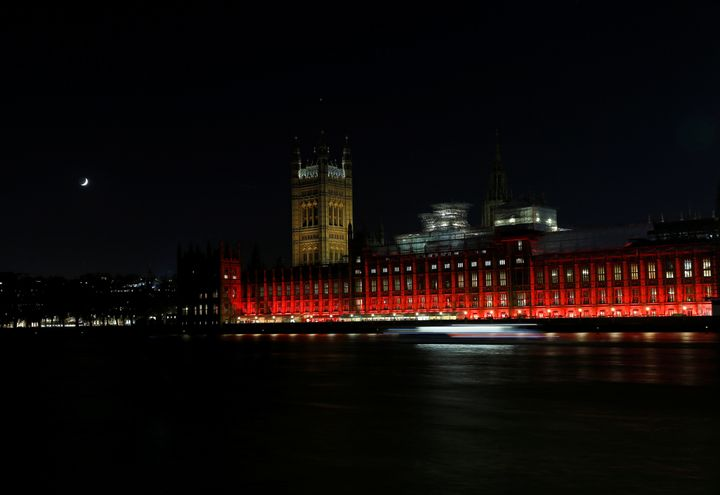 The Houses of Parliament in Westminster are floodlit in red light to mark #RedWednesday onNov. 22 in London, England.